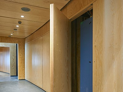 Pivot doors with a surface made from pine.